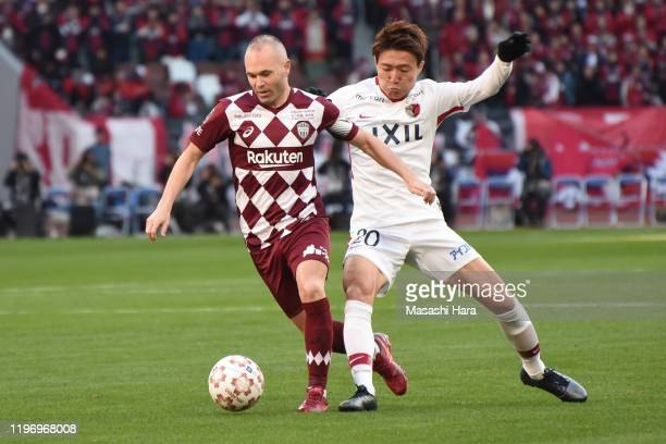 Andres Iniesta of Vissel Kobe and Kento Misao of Kashima Antlers compete for the ball during the 99th Emperor's Cup final between Vissel Kobe and...