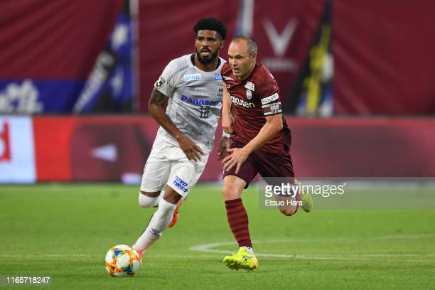 Andres Iniesta of Vissel Kobe and Patric of Gamba Osaka compete for the ball during the J.League J1 match between Vissel Kobe and Gamba Osaka at...