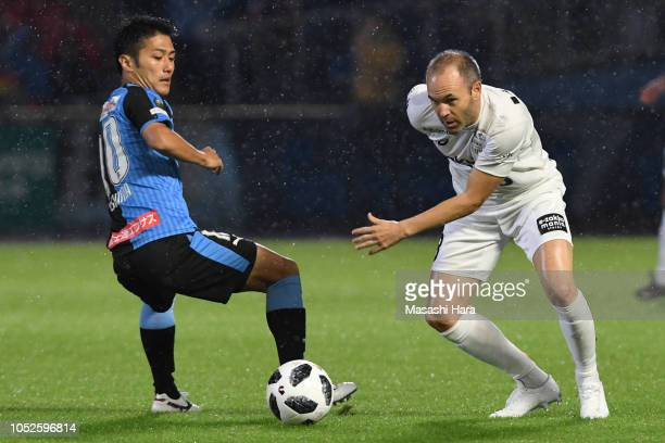 Andres Iniesta of Vissel Kobe and Ryota Oshima of Kawasaki Frontale compete for the ball during the JLeague J1 match between Kawasaki Frontale and...
