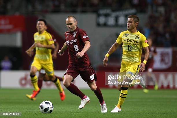 Andres Iniesta of Vissel Kobe and Ryuta Koike of Kashiwa Reysol compete for the ball during the JLeague J1 match between Vissel Kobe and Kashiwa...