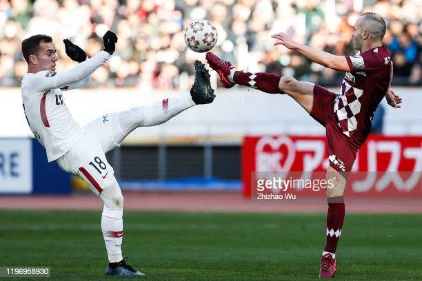 Andres Iniesta of Vissel Kobe competes for the ball with Serginho of Kashima Antlers during the 99th Emperor's Cup final between Vissel Kobe and...