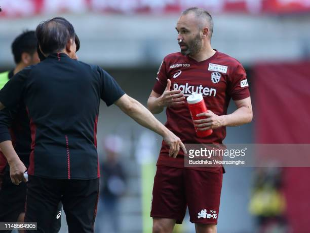 Andres Iniesta of Vissel Kobe is treated after injured his nose during the J.League J1 match between Vissel Kobe and Kashima Antlers at Noevir...