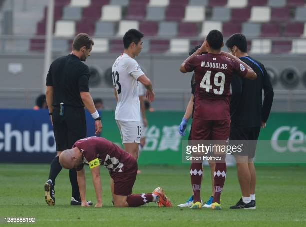 Andres Iniesta of Vissel Kobe on the ground injured during the AFC Champions League Round of 16 match between Vissel Kobe and Shanghai SIPG at the...
