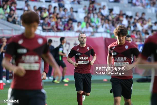 Junya Tanaka of Vissel Kobe and Kunitomo Suzuki of Shonan Bellmare compete for the ball during the JLeague J1 match between Vissel Kobe and Shonan...