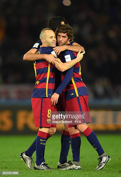 Andres Iniesta, Sergio Busquets and Sergi Roberto of Barcelona celebrate their team's 3-0 victory during the FIFA Club World Cup Final between River...