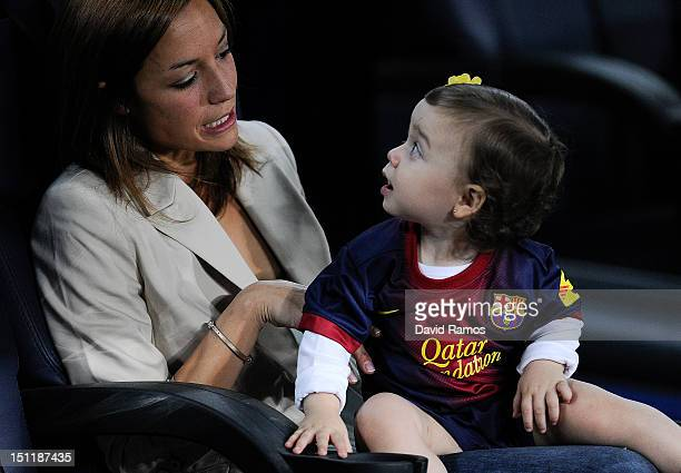 Andres Iniesta's wife Anna Ortiz and his daughter Valeria are seen prior to the La Liga match between FC Barcelona and Valencia CF at Camp Nou on...