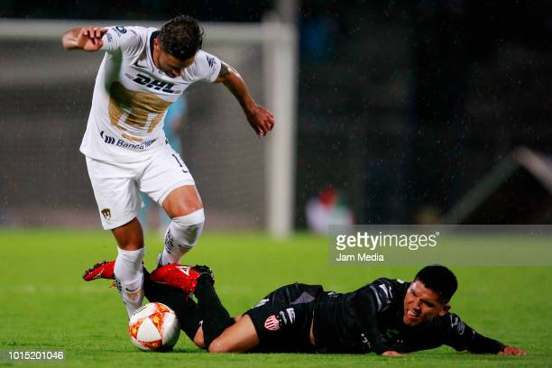Andres Iniestra of Pumas fights for the ball with Martin Barragan of Necaxa during the match between Pumas UNAM and Necaxa as part of the Copa MX...