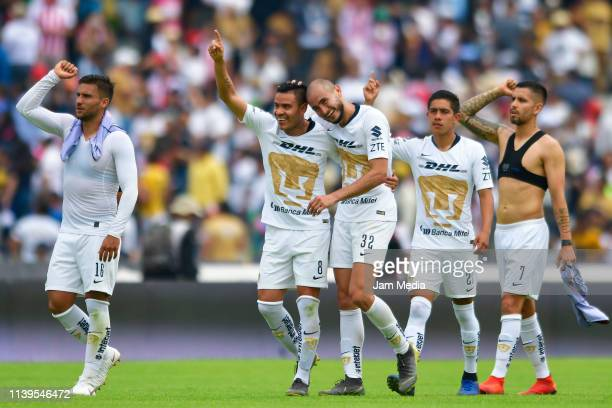 Andres Iniestra Pablo Barrera Carlos Gonzalez Idekel Dominguez and David Cabrera of Pumas celebrate after winning the 12th round match between Pumas...