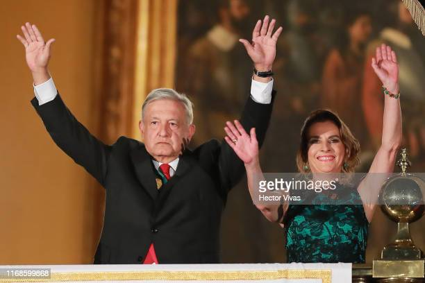 Andres Manuel Lopez Obrador president of Mexico and his wife Beatriz Gutierrez Muller gesture during the celebrations of Mexico's Independence Day at...