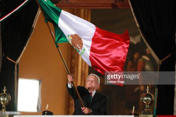 Andres Manuel Lopez Obrador, president of Mexico waves a flag of Mexico during the celebrations of Mexico's Independence Day at Zocalo on September...