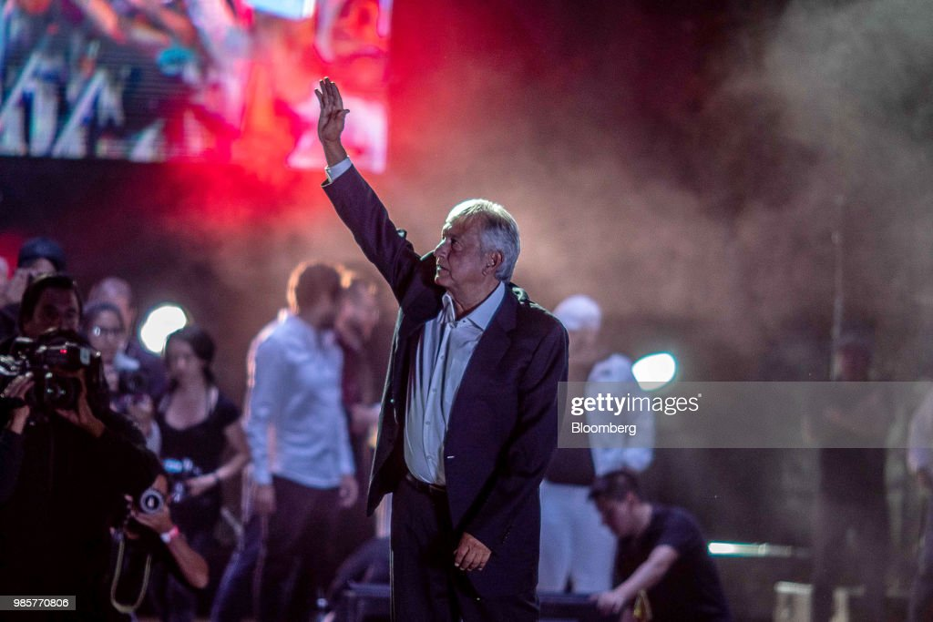 Andres Manuel Lopez Obrador, presidential candidate of the National Regeneration Movement Party (MORENA), greets the crowd during the final campaign rally at the Estadio Azteca in Mexico City, Mexico, on Wednesday, June 27, 2018. Lopez Obrador promises to put the poor first with a raft of new social programs -- and to stand up to the U.S. President, who has been denouncing Mexico since before he got elected. Photographer: Alejandro Cegarra/Bloomberg via Getty Images