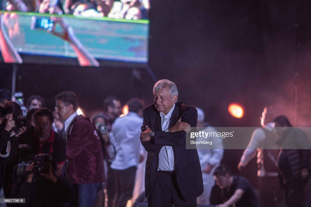 Andres Manuel Lopez Obrador, presidential candidate of the National Regeneration Movement Party (MORENA), gestures to the crowd during the final campaign rally at the Estadio Azteca in Mexico City, Mexico, on Wednesday, June 27, 2018. Lopez Obrador promises to put the poor first with a raft of new social programs -- and to stand up to the U.S. President, who has been denouncing Mexico since before he got elected. Photographer: Alejandro Cegarra/Bloomberg via Getty Images