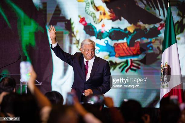 Andres Manuel Lopez Obrador salutes attendants after his virtual victory in the elections for the Presidency of Mexico in the Media Center at the...