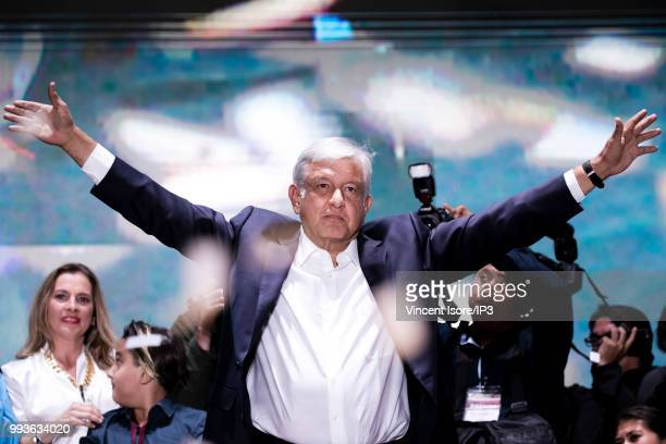 Andres Manuel Lopez Obrador waves as he celebrates his victory on the stage at Zocalo Square on July 1 2018 in Mexico City Mexico Presidential...