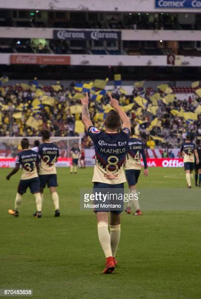 Andres Mateus Uribe of America celebrates with teammates after scoring the first goal of his team during the 16th round match between America and...