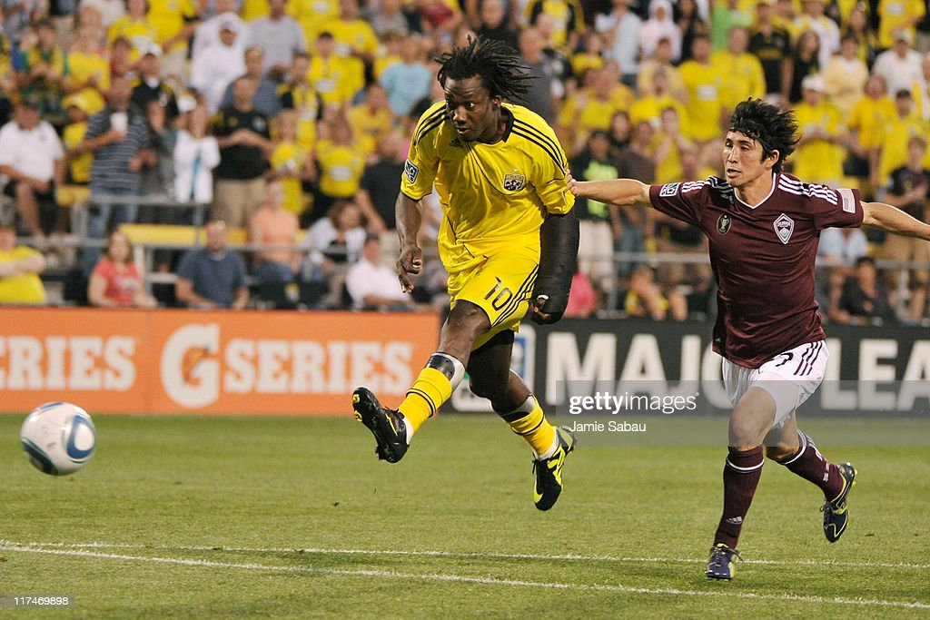 Andres Mendoza #10 of the Columbus Crew scores on a breakaway in the second half in front of Kosuke Kimura #27 of the Colorado Rapids on June 26, 2011 at Crew Stadium in Columbus, Ohio. It was Mendoza's second goal of the game in Columbus' 4-1 win over Colorado.