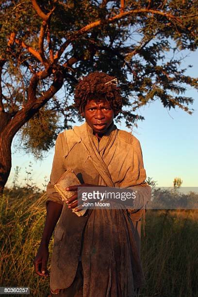 Andres, mentally ill and homeless, carries a book of statistics March 20, 2008 while walking the highway outside of Bulawayo, Zimbabwe. The nation,...
