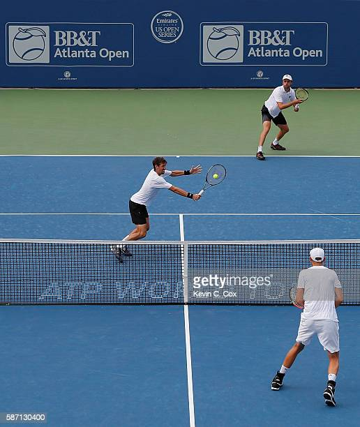 Andres Molteni of Argentina returns a backhand to Johan Brunstrom and Andreas Siljestrom of Sweden during the finals of the BBT Atlanta Open at...