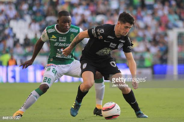 Andres Mosquera of Leon and Angelo Sagal of Pachuca fight for the ball during the 9th round match between Leon and Pachuca as part of the Torneo...