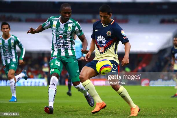 Andres Mosquera of Leon struggles for the ball with Cecilio Dominguez of America during the 11th round match between America and Leon as part of the...