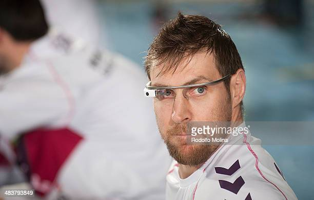 Andres Nocioni #5 of Laboral Kutxa Vitoria with Google Glasses warming up before the 20132014 Turkish Airlines Euroleague Top 16 Date 14 game between...
