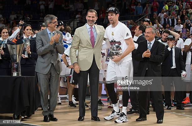 Andres Nocioni #6 of Real Madrid and MVP of the Final receives the MVP Trophy from Jordi Bertomeu President and CEO Euroleague Basketball and King...