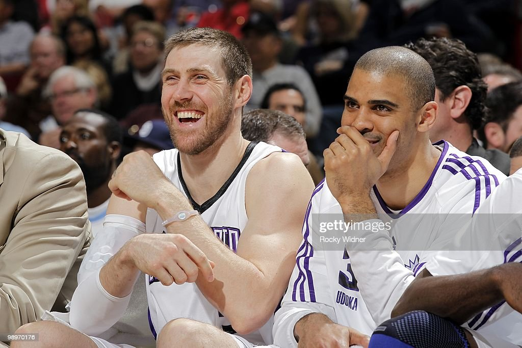 Andres Nocioni #5 and Ime Udoka #3 of the Sacramento Kings share a laugh on the bench during the game against the Dallas Mavericks at Arco Arena on April 10, 2010 in Sacramento, California. The Mavs won 126-108.