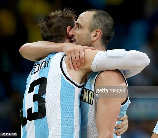 Andres Nocioni and Manu Ginobili of Argentina celebrate the 111107 double overtime win over Brazil during the Men's Preliminary Round Group B match...