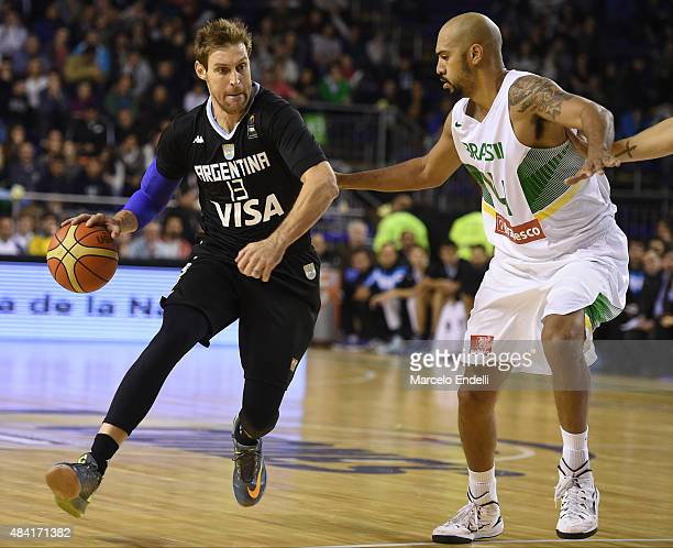 Andres Nocioni of Argentina drives against Juan Anderson of Brazil during a match between Argentina and Brazil as part of Four Nations Championship...