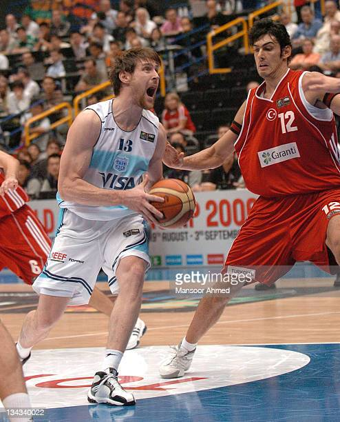 Andres Nocioni of Argentina drives in the paint as Turkey forward Kerem Gonlum tries to prevent him during the FIBA World Championship 2006...