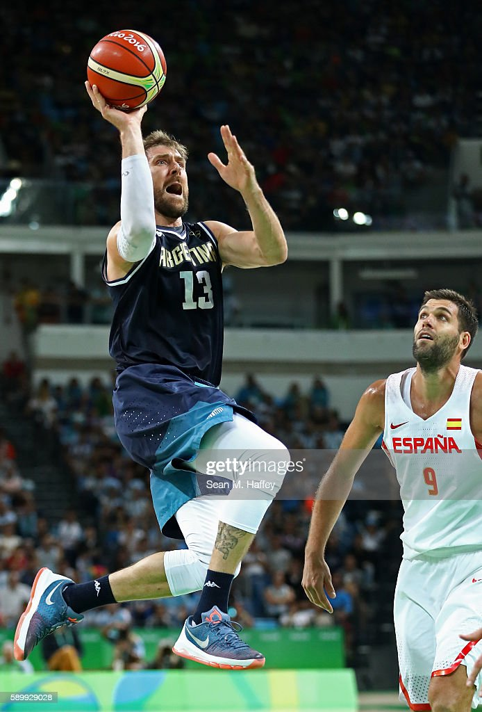 Andres Nocioni #13 of Argentina shoots against Felipe Reyes #9 of Spain during a Men's Basketball Preliminary Round Group B game between Spain and Argentina on Day 10 of the Rio 2016 Olympic Games at Carioca Arena 1 on August 15, 2016 in Rio de Janeiro, Brazil.