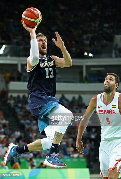 Andres Nocioni of Argentina shoots against Felipe Reyes of Spain during a Men's Basketball Preliminary Round Group B game between Spain and Argentina...