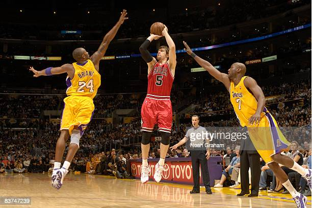 Andres Nocioni of the Chicago Bulls shoots defended by Kobe Bryant and Lamar Odom of the Los Angeles Lakers at Staples Center on November 18 2008 in...