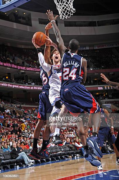 Andres Nocioni of the Philadelphia 76ers shoots against Al Horford and Marvin Williams of the Atlanta Hawks during the game on October 29 2010 at the...