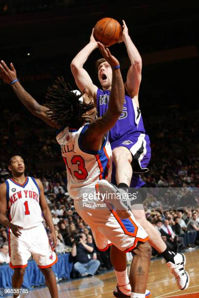 Andres Nocioni of the Sacramento Kings shoots against Jordan Hill of the New York Knicks during the game on February 9 2010 at Madison Square Garden...
