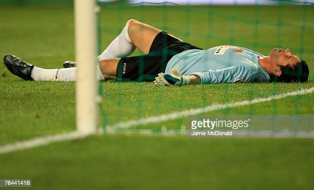 Andres Palop of Sevilla looks dejected as AC Milan score their third goal during the UEFA Super Cup between AC Milan and Sevilla at the Stade Louis...