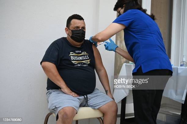 Andres Pelaez receives his first Pfizer Covid-19 vaccine at a clinic hosted by The Tournament of Roses in partnership with the Pasadena Public Health...