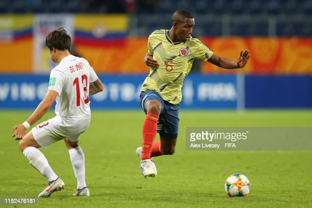 Andres Perea of Colombia competes for the ball with Kalahani Beumert of Tahiti during the 2019 FIFA U-20 World Cup group A match between Colombia and...
