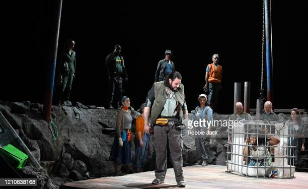 Andres Presno as First Elder and Masabane Cecilia Rangwanasha as Susanna with artists of the company in The Royal Opera's production of George...