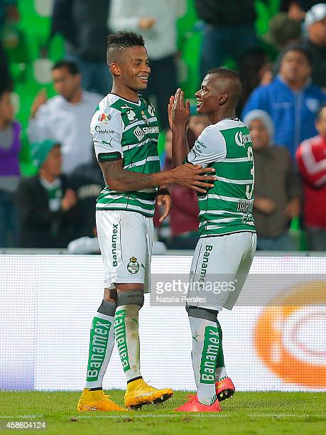 Andres Renteria celebrates with Carlos Darwin Quintero after scoring the winning goal during a match between Santos Laguna and Pachuca as part of...