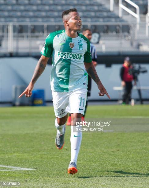 Andres Renteria of Colombian side Atletico Nacional celebrates after scoring a goal against Brazilian club Atletico Mineiro during the first half of...