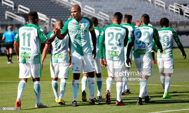 Andres Renteria of Colombian side Atletico Nacional greets teammates after scoring a goal against Brazilian club Atletico Mineiro during the first...