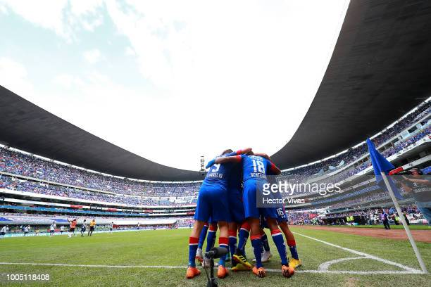 Andres Renteria of Cruz Azul celebrate with teammates after scoring the opening goal of his team during the 1st round match between Cruz Azul and...