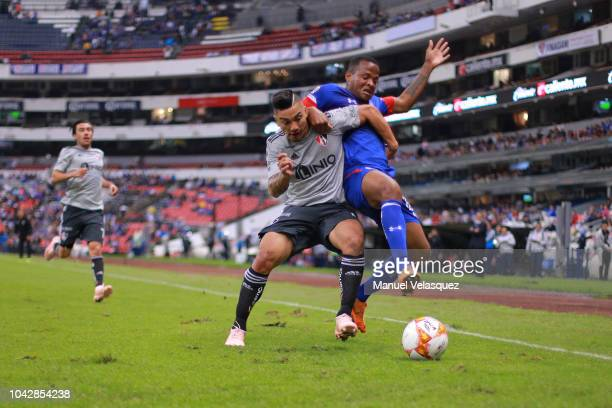 Andres Renteria of Cruz Azul struggles for the ball against Lorenzo Reyes of Atlas during the 10th round match between Cruz Azul and Atlas as par of...