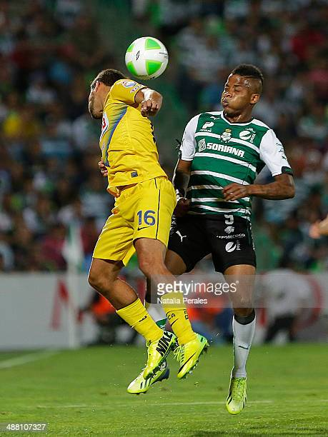Andres Renteria of Santos and Adrian Aldrete of America fight for the ball during the Quarterfinal second leg match between Santos Laguna and America...