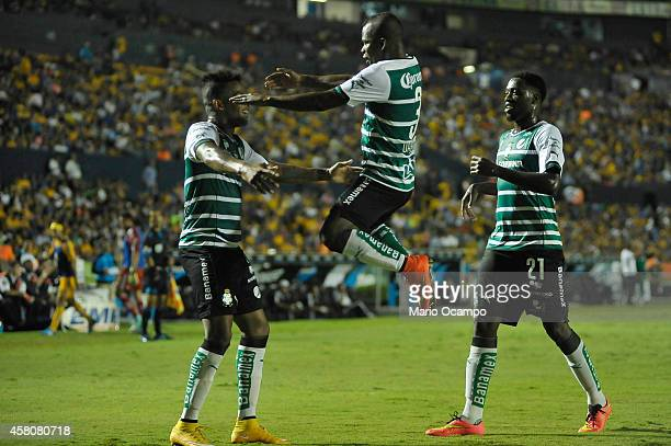 Andres Renteria of Santos celebrates with teammates after scoring his team's second goal during a semifinal match between Tigres UANL and Santos...
