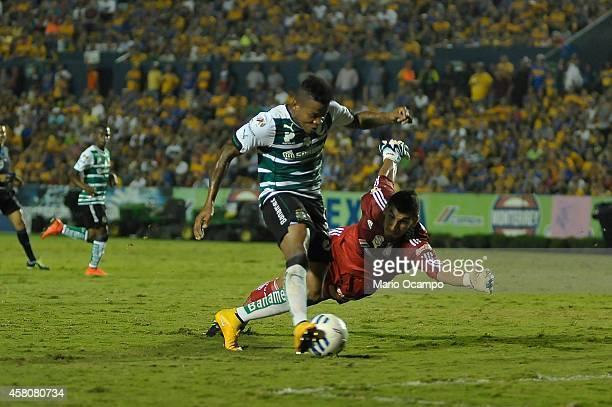 Andres Renteria of Santos kicks the ball and scores his team second goal during a semifinal match between Tigres UANL and Santos Laguna as part of...