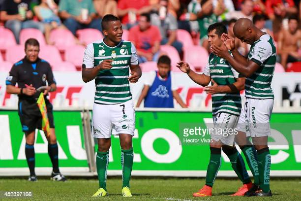 Andres Renteria of Santos Laguna celebrates with teammates after scoring the first goal of his team during a match between Veracruz and Santos Laguna...