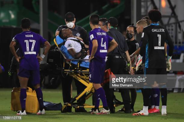 Andres Reyes of Inter Miami is carried off the field after receiving a foul during a match between Orlando City and Inter Miami as part of MLS is...