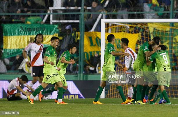 Andres Rios of Defensa y Justicia celebrates with teammates their team's third goal during a match between Defensa y Justicia and River Plate as part...